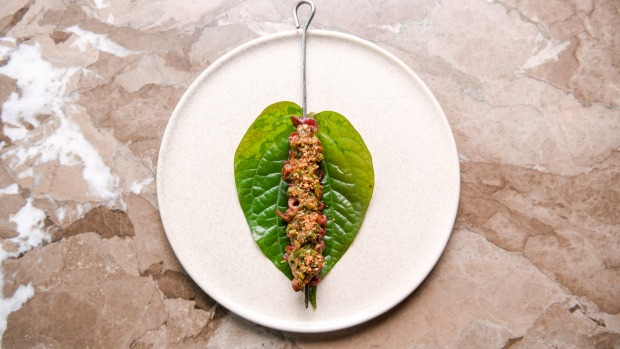Wagyu tongue skewer wrapped in a betel leaf.