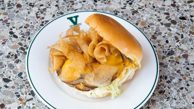 Fried mortadella sandwich with crisp luncheon meat, gooey cheese, iceberg lettuce and crispy potato chips.
