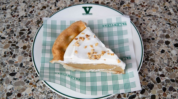 Banana cream pie nut-sprinkled with golden pastry, softly gooey banana puree and piled whipped cream.