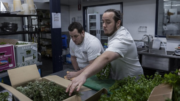 Sam (left) and Luke Bourke, collect produce at Stix Catering in Marrickville.