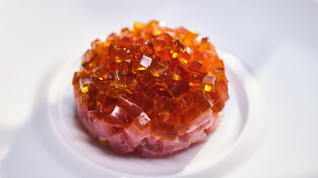 Bonito marinated withhousemadeyuzu kosho (a spicy condiment made with yuzufruit and chilli), topped with jewels of ...