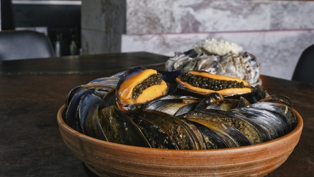 Mussels stuffed with caviar.