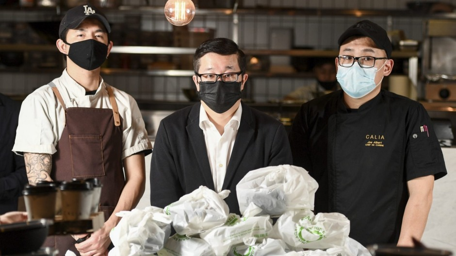 Restaurateur Jason Chang (centre) and his staff at Calia at Melbourne Emporium in the CBD, which is dealing with ...