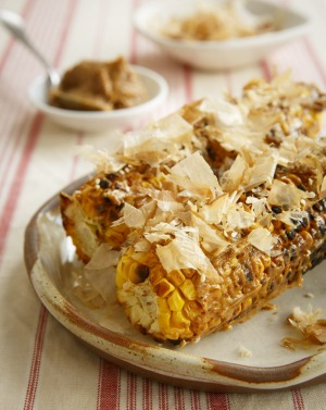 Grilled corn with miso butter and bonito flakes (katsuobushi).