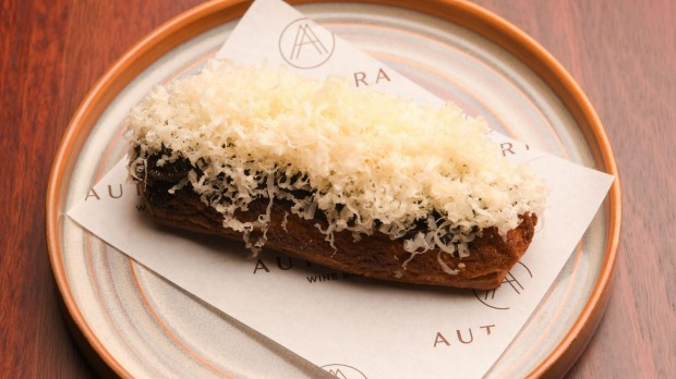 Cheese eclair showered in comte.