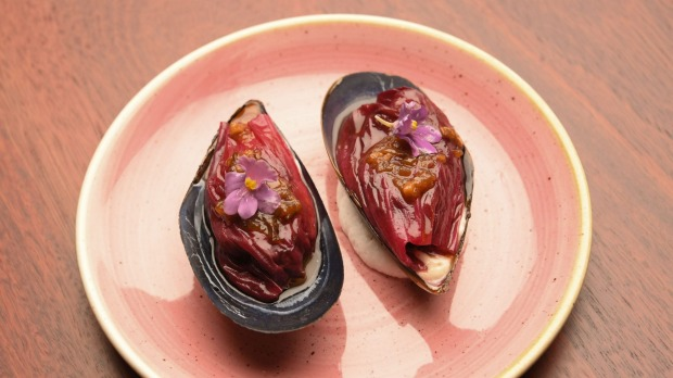 Mussels with XO and aioli, draped in radicchio.