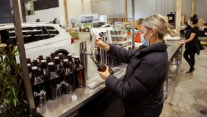 Daisy Geale prepares orders at The Bella Vista Hotel, which has launched a drive-through service offering take-home ...