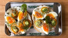 Soft-boiled egg bagel with avocado, dukkah and a caper and dill schmear at Comma Tuckshop, now open in Moorabbin.