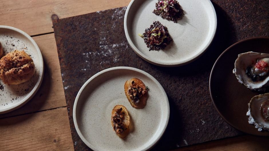 Opening snacks might include cheesy gougere with mountain pepper (left) and angasi oyster with finger lime (right).