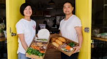 Ly Dan and David Phan, co owners of Lit Canteen in Alexandria, with their make-it-yourself banh mi and rice paper roll boxes.