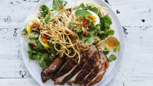 Spiced pork chops with boiled eggs, crispy noodles  and slaw.