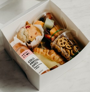 The $18 home-schooling lunch box from Boosa cafe in Bentleigh East includes a mini ham and cheese croissant, muffin, ...