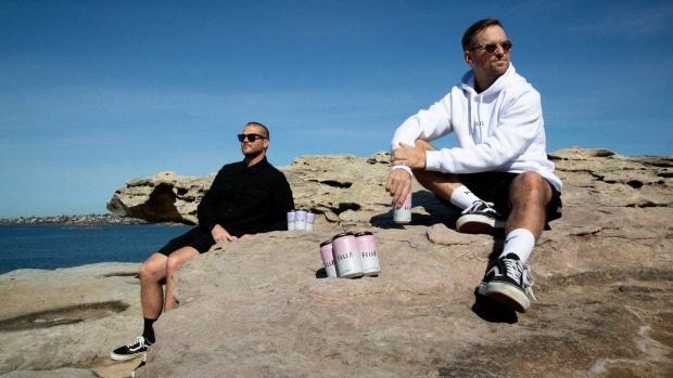 Founders of Fellr Andy Skora (left) and Will Morgan, with their seltzer cans in Sydney.