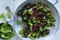 Adam Liaw's stir-fried lamb with coriander and Sichuan pepper.