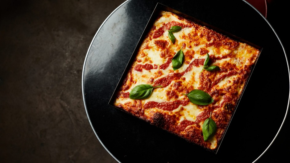 The cheese pizza from Connie's, which measures seven centimetres deep and 30 centimetres on each side.
