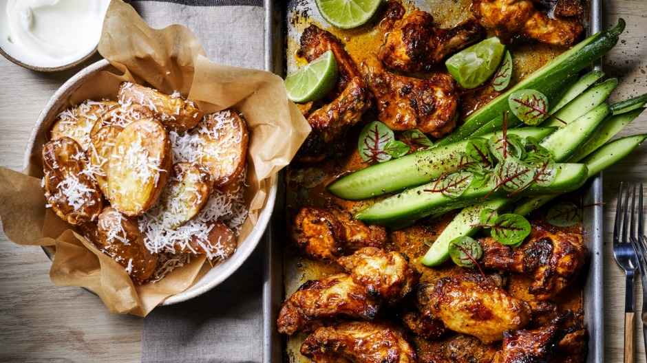 Charred tandoori chicken wings with crunchy coconut potatoes.