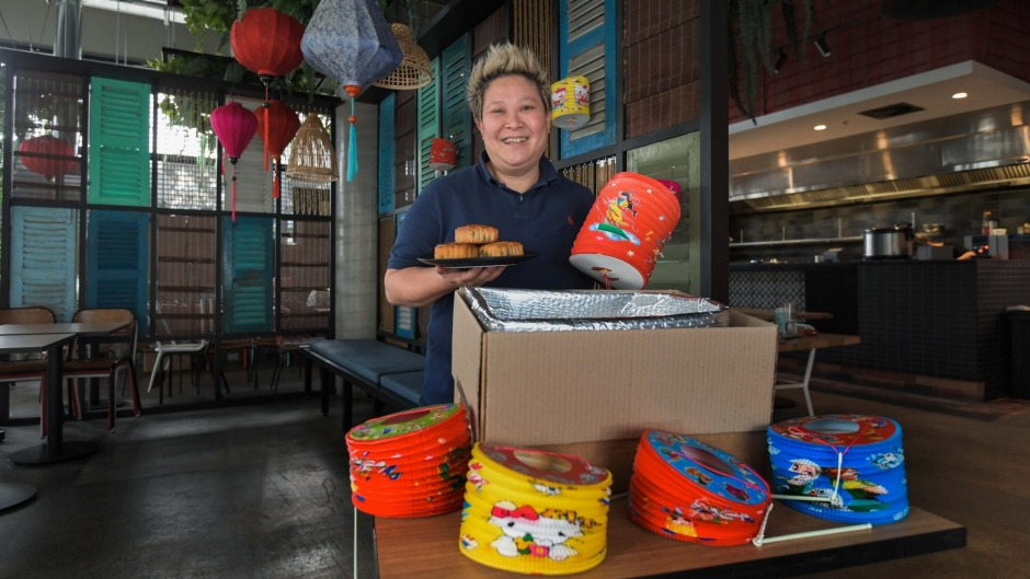 Chef Jerry Mai packaging special Mid-Autumn Festival food and paper lanterns at her Vietnamese beer hall Bia Hoi.