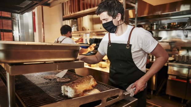 Josh Niland on the grill with Murray cod at Charcoal Fish.
