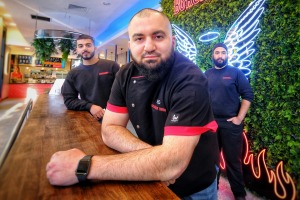 """""""We just want to serve our customers and welcome people through the doors."""" From left, Ismail Oumacha, Hash Tayeh and ..."""