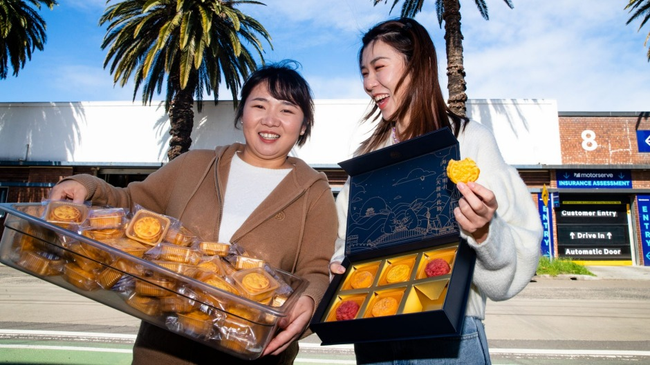 Dulcet Cakes & Sweets owner Vivienne Li (left) and baker Juno Zhu outside their mooncake manufacturing site in Marrickville.