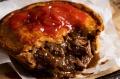 The perfect Aussie meat pie served with sauce, of course.