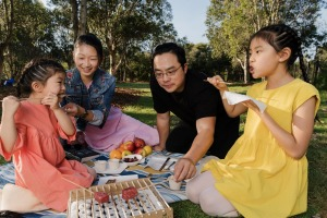 Firepop owners Alina Van and Raymond Hau charcoal grill with their daughters Arielle, 4, and Ariana, 9, at Sydney Park ...