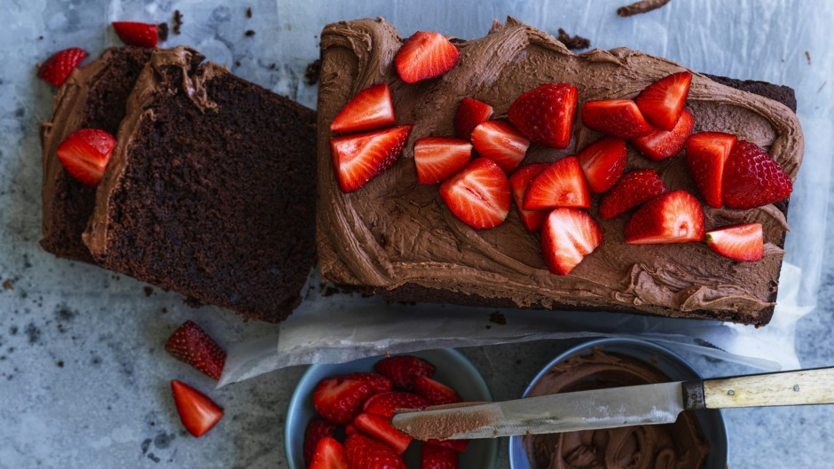 """Beetroot chocolate cake with """"the world's easiest icing"""" and fresh strawberries."""