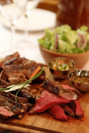 The one dish you must try ... Parillada of lomo (sirloin), matambre (thin skirt steak), costilla (ribs) with chimichurri ...